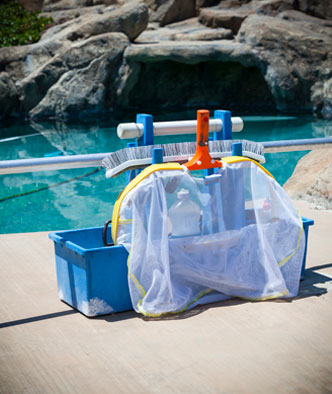 pool cleaning equipment in front of a luxurious pool