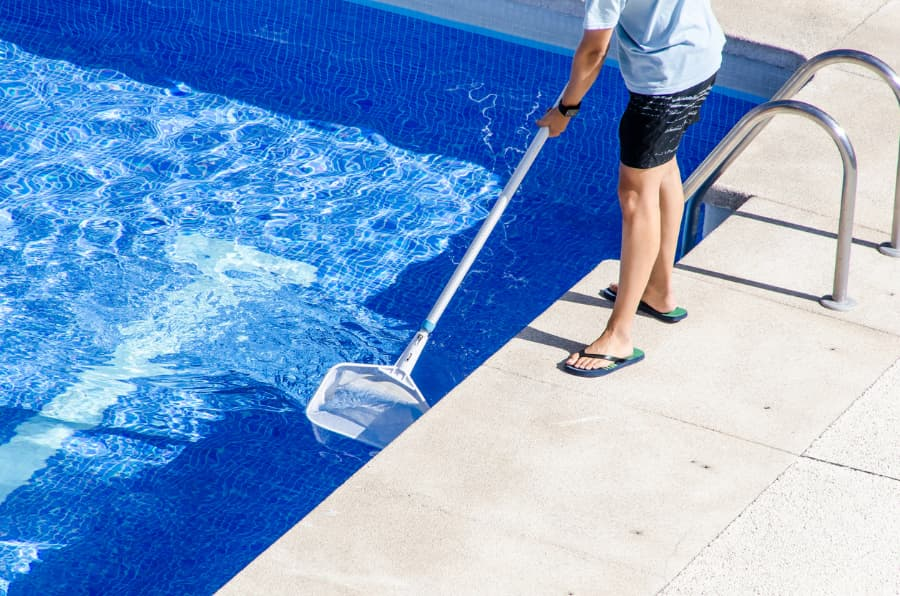 Cleaning Swimming Pool With Net