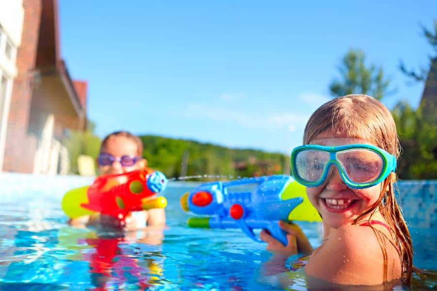 Kids With Water Guns In Pool